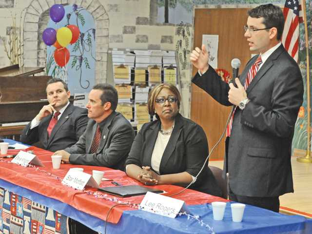 Candidates from left, Edward Headington, Steve Knight, Star Moffatt and Lee Rogers address questions at  a candidate forum held at the Santa Clarita Valley Senior Center in Newhall on Thursday evening.