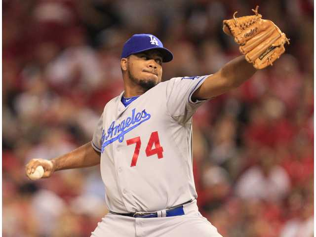 Los Angeles Dodgers relief pitcher Kenley Jansen throws against the Cincinnati Reds on Friday in Cincinnati.