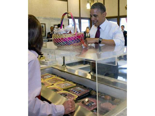 President Barack Obama picks out sausages at Usinger's Sausage, Saturday, Sept. 22, 2012, in Milwaukee.