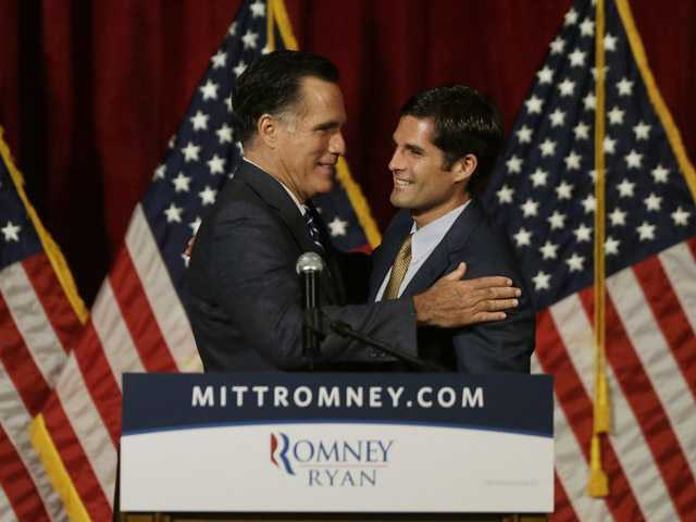 Mitt Romney, left, is introduced by his son Matt before he speaks at a campaign fundraising event in Del Mar on Saturday.