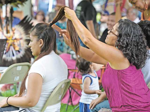 Native Americans socialize, dance at annual powwow at Newhall park