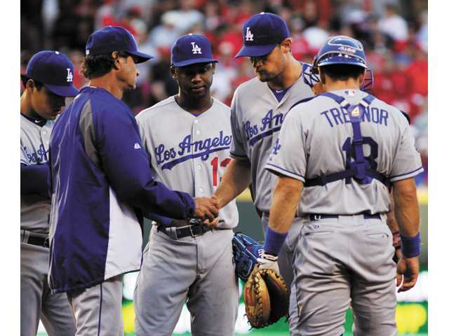 L.A. loses 6-0 to Reds, falls back in race