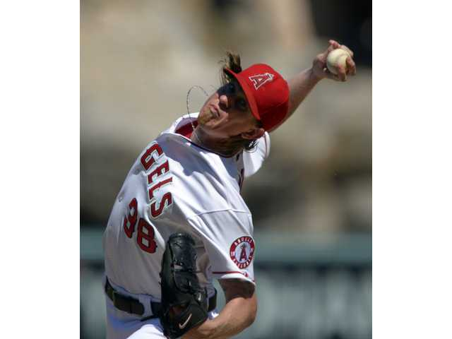 Los Angeles Angels starting pitcher Jered Weaver throws against the Chicago White Sox on Sunday in Anaheim.