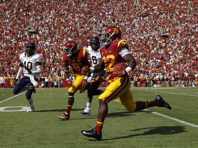 Southern California running back Curtis McNeal, center, runs with the ball during the first half of against California in Los Angeles, Saturday.