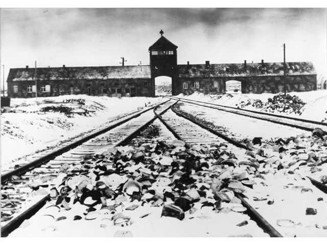 Germany has launched a war crimes investigation against an 87-year-old Philadelphia man it accuses of serving as an SS guard at the Auschwitz death camp.