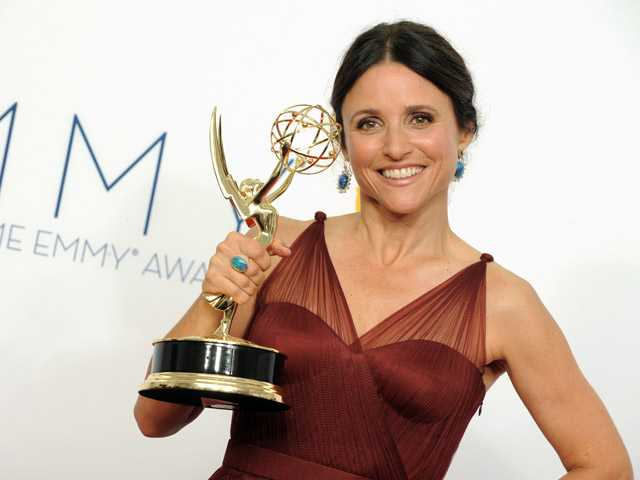 Actress Julia Louis-Dreyfus poses backstage at the 64th Primetime Emmy Awards at the Nokia Theatre on Sunday in Los Angeles.