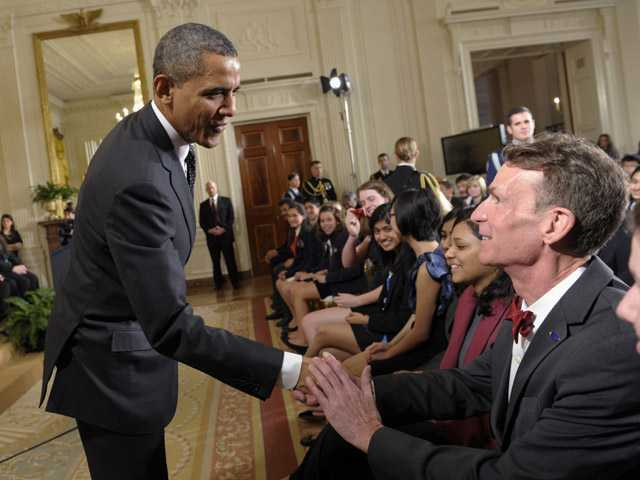 In this Feb. 7 photo, President Barack Obama shakes hands with Bill Nye during an event in the East Room of the White House in Washington.