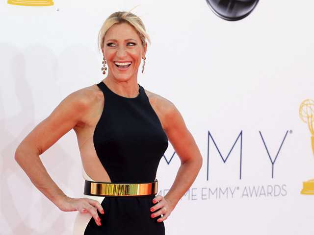 Edie Falco arrives at the 64th Primetime Emmy Awards at the Nokia Theatre on Sunday in Los Angeles.