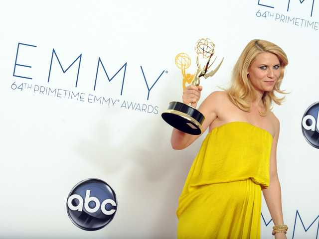 Actress Claire Danes poses backstage at the 64th Primetime Emmy Awards at the Nokia Theatre on Sunday in Los Angeles.