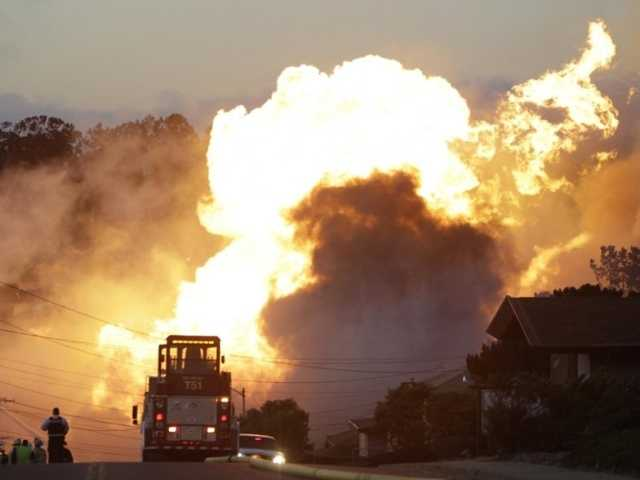 A massive fire is roars through a residential neighborhood in San Bruno, Calif. when a piepline owned Pacific Gad and Electric erupted Sept. 2010. Associated Press
