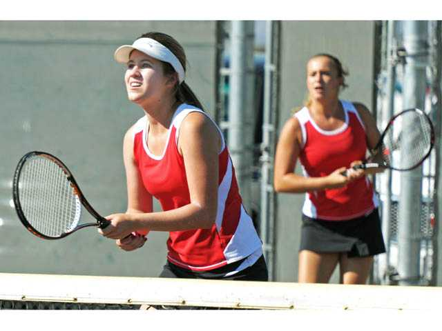 Hart's team of Brooke Seward, left, and Carissa Costanza plays against Golden Valley on Monday at Golden Valley High.