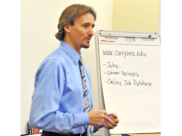 Anthony Michaelides, director of Career Services at College of the Canyons, discusses interviewing skills at the Youth Job Academy, held at the Santa Clarita Activities Center on Friday.