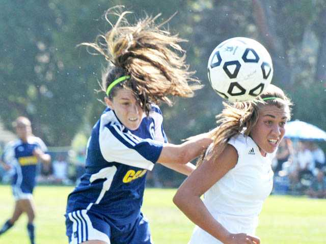College of the Canyons forward Stacey Atwater heads the ball over against Santa Monica College on Tuesday at COC.