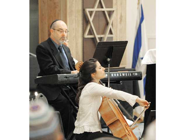 Pianist Norman Krieger, left, and celist Andrea Casarrubios perform Kol Nidre as Congregation Beth Shalom observes Yom Kippur, aka Day of Atonement, which is the holiest day of the year for the Jewish people.