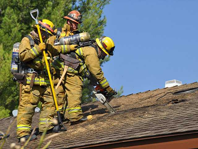 Firefighters with the Los Angeles County Fire Department used axes and a chain saw to get into the attic. The fire was promptly extinguished, and no one was reported hurt.