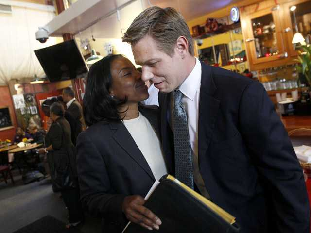California Rep. candidate Eric Swalwell, right, hugs Meredith Brown, president of the Alameda County Democratic Lawyers Club during the Club's endorsement meeting on Sept. 7 at Everett & Jones Barbeque in Oakland.