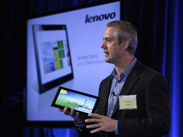 Tom Butler, Director of Lenovo ThinkPad Marketing, speaks while holding a Lenovo tablet Thursday in San Francisco.