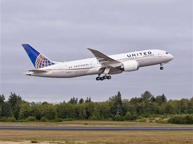 In this undated photo provided by Boeing Commercial Airplanes, the first Boeing 787 that will be used by United Airlines, is shown taking off. The ultra-lightweight jet aims to reduce flier fatigue and airline fuel bills.