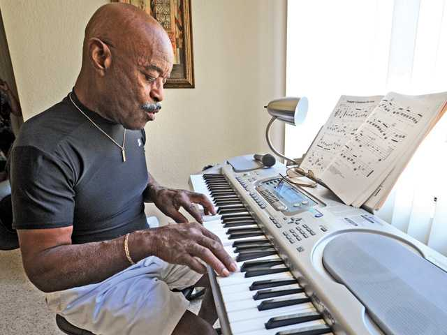 Hendricks plays on his keyboard in his home studio.