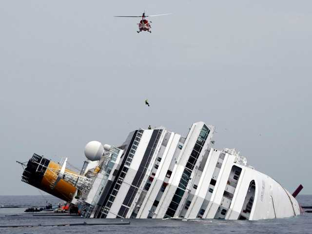 "This Jan. 31, 2012 photo shows the grounded cruise ship Costa Concordia off the Tuscan island of Giglio, Italy. The crew of the Costa Concordia has just been awarded the ""Seafarer of the Year"" award."