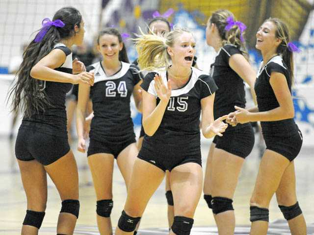 Valencia High middle blocker Kellie Kleszcz and the Vikings celebrate a point against the Saugus Centurions on Thursday at Valencia. The Vikings made quick work of Saugus, winning in three games to open the Foothill season.