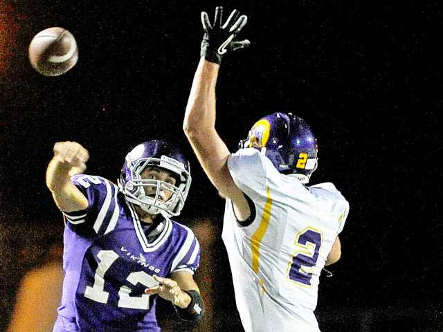 Valencia quarterback Sean Murphy throws against Righetti on Sept. 14 at Valencia High School.