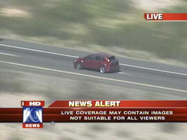 In this video grab provided by Fox 10 News, a vehicle involved in a police car chase is followed on a highway by a helicopter west of Phoenix on Friday.