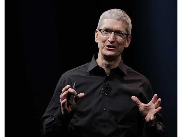 Apple CEO Tim Cook speaks during an introduction of the new iPhone 5 in San Francisco,