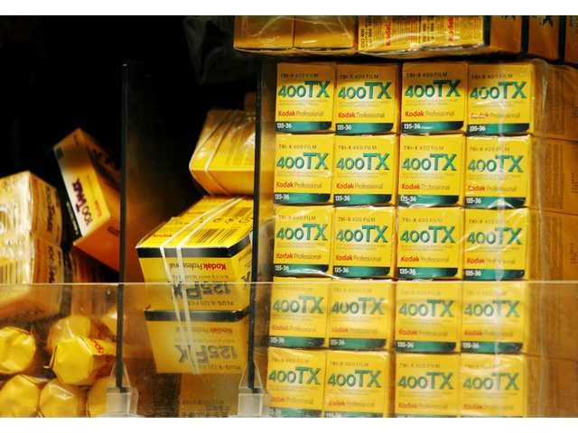 Boxes of Kodak Tri-X 35mm black and white film, right, are shown on a shelf at B&H Photo & Video, in New York.