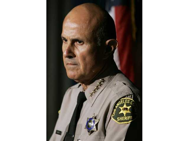 This June 8, 2007 file photo shows Los Angeles County Sheriff Lee Baca addressing the media in Monterey Park, Calif.