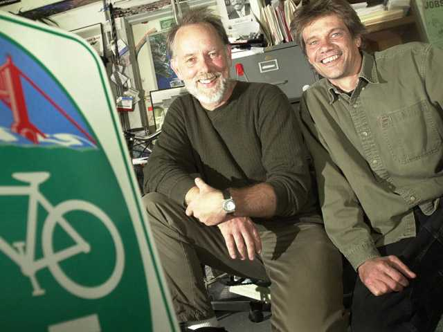 Chris Carlsson, right, and Jim Swanson, pose in San Francisco on Sept. 26, 2002. The pair came up with the idea for Critcal Mass, a monthly gathering of bike riders, 10 years ago.