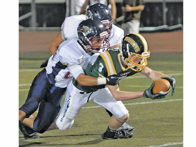 Canyon High's Brenden Stach (3) stretches for extra yards during Friday's game against Steele Canyon.
