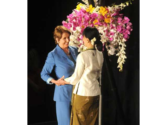 Nancy Pelosi, left, embraces Nobel Peace Laureate and Myanmar opposition leader Aung San Suu Kyi at the University of San Francisco on Saturday.
