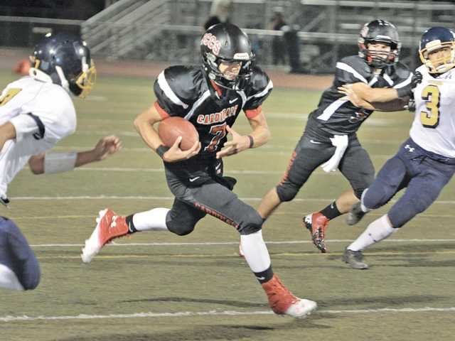 Prep football: Cards keep cruising