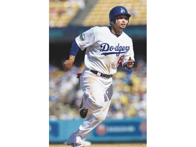 Los Angeles Dodgers left fielder Shane Victorino rounds third base on Sunday in Los Angeles.