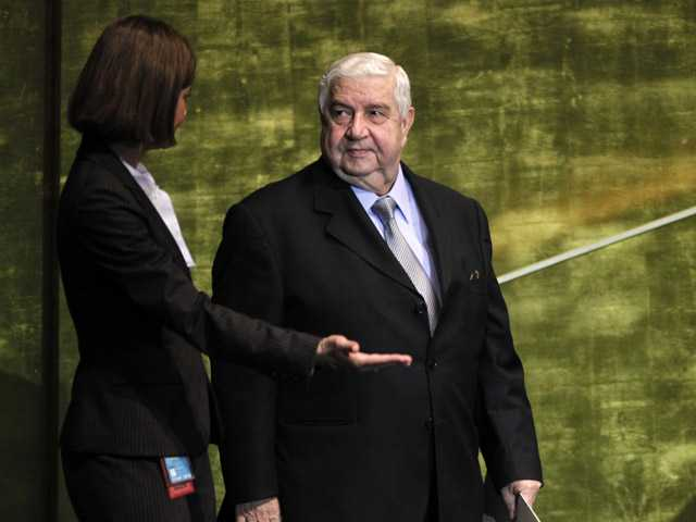 Walid al-Moallem, Foreign Minister of Syria, is guided to the podium before speaking at the 67th session of the United Nations General Assembly.