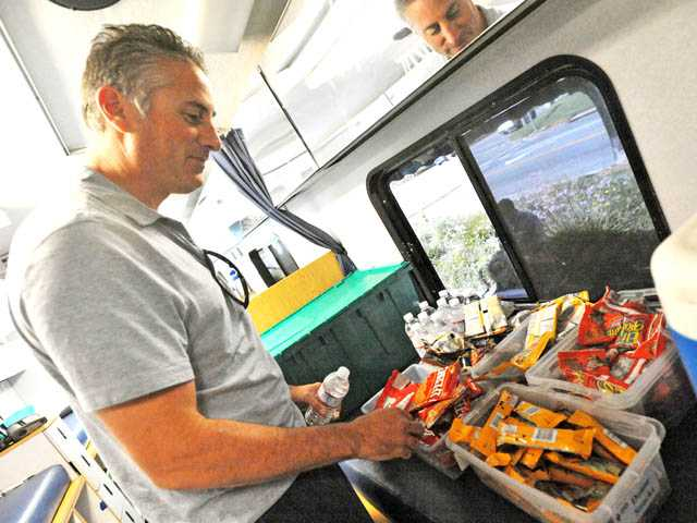 Terry Bleecker, of Valencia, takes his pick of snacks after he donates blood. (Jonathan Pobre/The Signal)