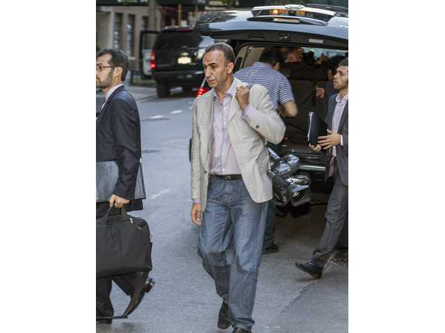 Hassan Gol Khanban, cameraman assigned to the Iranian Presidential detail, center, arrives at the Warwick Hotel in New York.