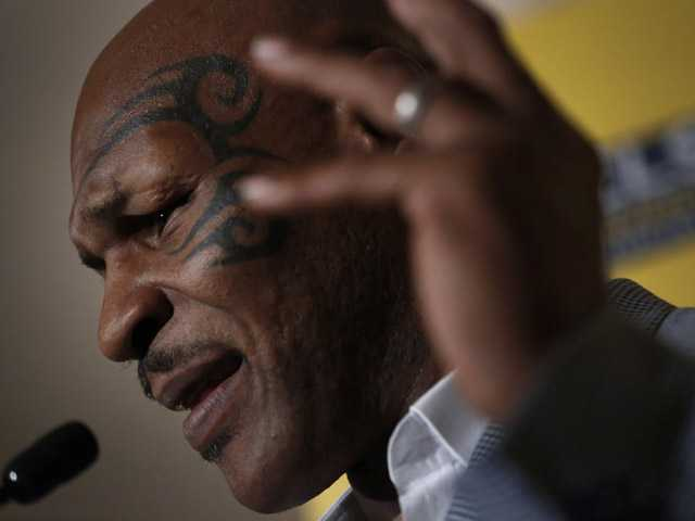 Mike Tyson speaks a press conference at the 19th Credit Lyonnais Securities Asia (CLSA) investors Forum at a hotel in Hong Kong.
