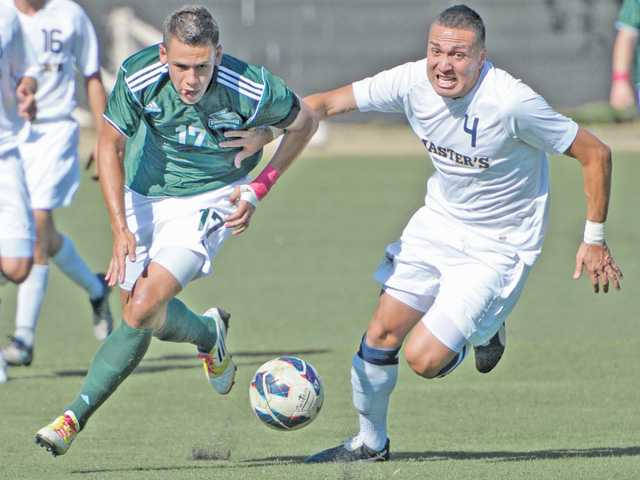 TMC's Ricardo Vazquez, right, battles for the ball at midfield with Concordia University's Christian Ramirez in the first half at The Master's College on Tuesday.