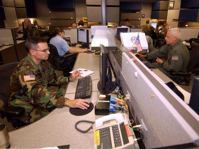 In this 2004 photo, unidentified analysts at the Combined Intelligence and Fusion Center for NORAD/Northcom in Colorado Springs, Colo.