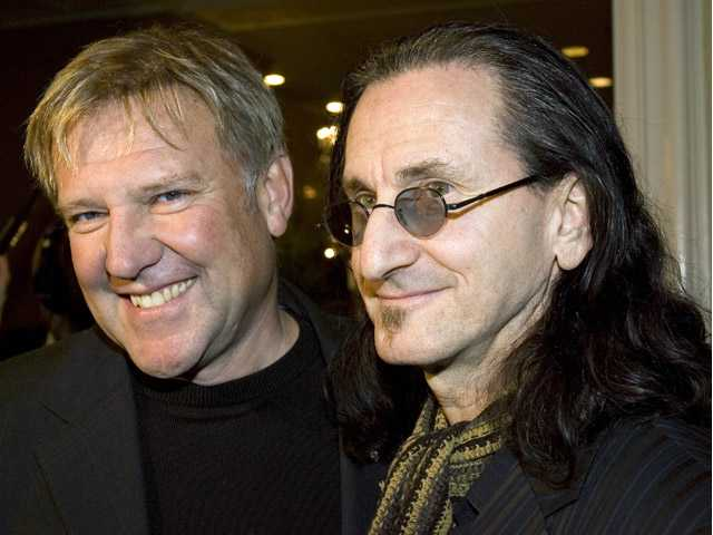 Alex Lifeson, left, and Geddy Lee of the rock band RUSH arrive for the Canadian Music Industry Awards in Toronto,in this March 8, 2007 file photo.