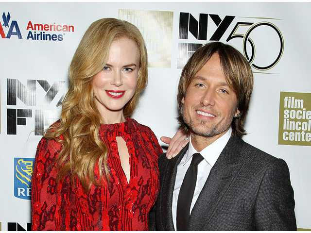 "This image released by Starpix shows actress and honoree Nicole Kidman, left, and her husband Keith Urban at a gala by The Film Society of Lincoln Center following by the premiere of her film, ""The Paperboy"" at the 2012 New York Film Festival at Alice Tully Hall, Wednesday, Oct. 3, 2012 in New York."