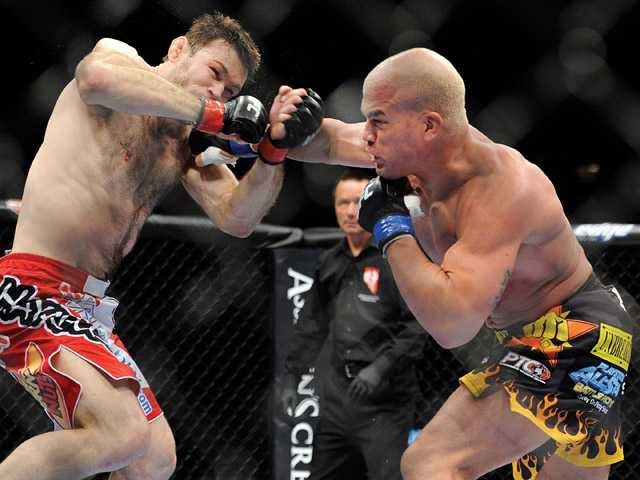 Forrest Griffin, left, and Tito Ortiz battle it out during their UFC 148 light heavyweight fight on July 7 in Las Vegas.