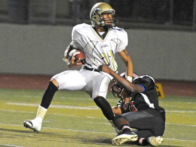 SCCS's Larue Nixon, right, drags down Kilpatrick's Michael Rodriguez on Thursday at Valencia High School.