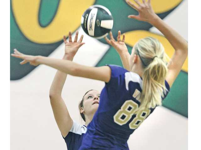 Valencia's Lindsey Knudsen, left, sets for Teresa Cernosek (88) against Canyon at Canyon High on Thursday.