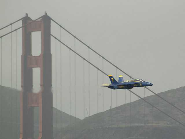 A Navy Blue Angels F/A-18 flies past the Golden Gate Bridge in San Francisco on Thursday.