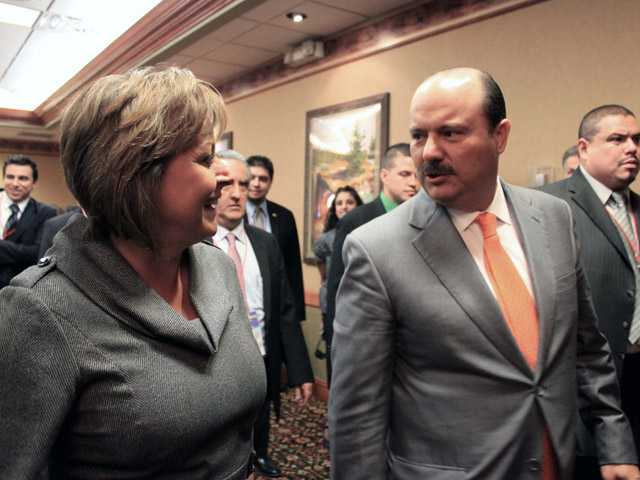 New Mexico Gov. Susana Martinez, left, and Gov. Cesar Duarte Jaquez talk following the 30th annual Border Governors Conference in Albuquerque, N.M., on Friday.