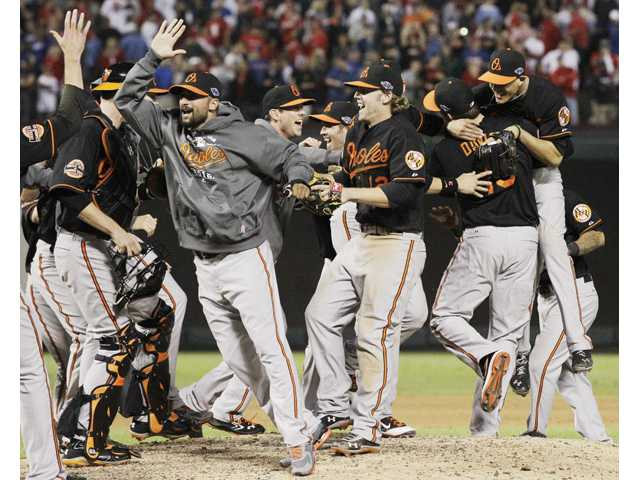 The Baltimore Orioles celebrate winning the American League wild-card playoff game against the Texas Rangers on Friday in Arlington, Texas.