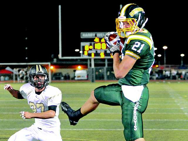 Canyon High's Drew Wolitarsky makes a catch for his first touchdown of the night against Golden Valley at Canyon High on Friday. Golden Valley's Ryan McNerney (27) looks on.